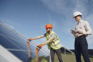 Technician and manager checking equipment for solar energy.